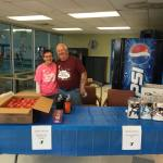 Our employees, Ellen + Joe, manning the snack station.