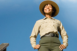 Photo of a park official wearing a hat and a long sleeved shirt.