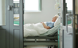 Elderly lady in hospital bed high risk for food poisoning