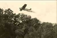 Aircraft spraying insecticide, 1920's