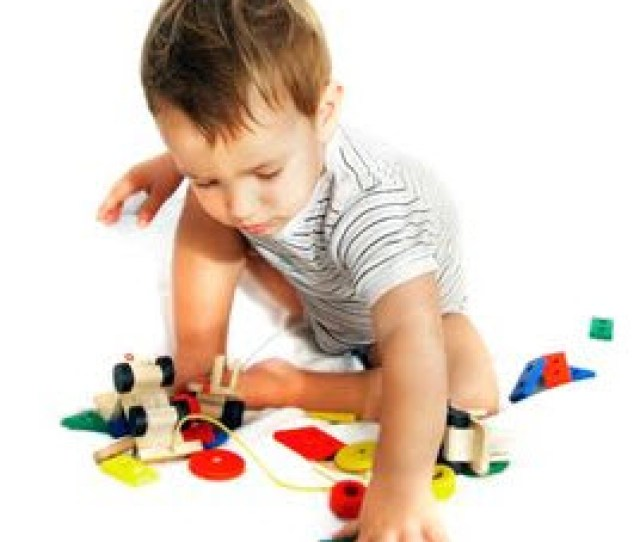 Photo Child Playing With Toys