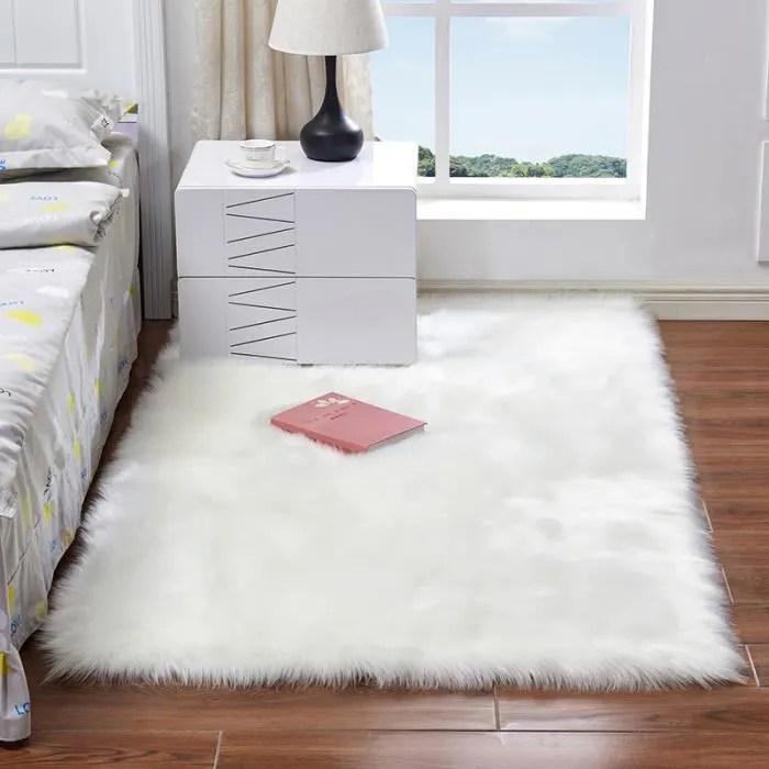 tapis de chambre salon l120xl60cm rectangulaire en simili mouton douce avec fils longues decoration couleur blanc
