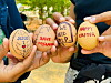Protesters hold eggs painted with protest messages to show resistance after the military coup.