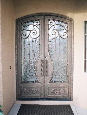 Puertas de portales de hierro y forja portales comunidad for Puertas de metal con diseno