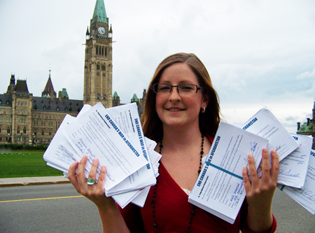 """Ceasefire.ca staffer Lauren Hunter delivered hundreds of """"End the War in Afghanistan"""" petitions to the Prime Minister's office"""
