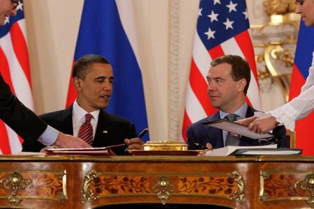 Presidents Barack Obama and Dmitry Medvedev sign the New START treaty in Prague