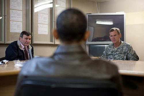 President Barack Obama meets with U.S. Ambassador Karl Eikenberry, left, and Gen. Stanley McChrystal at Bagram Air Field in Afghanistan, March 28, 2010