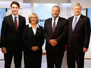Mulcair and Conservative Prime Minister Stephen Harper pose  ahead of the