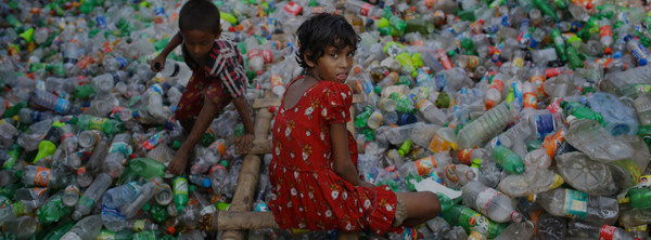 A young girl working at a plastic recycling factory in Dhaka, Bangladesh. © A.M. Ahad / Associated Press