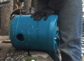 Drilling-holes-in-greywater-bucket