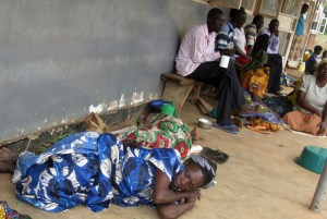Mothers sleep on the verandah at Anyeke Health Centre IV on Monday as they wait to be attended to