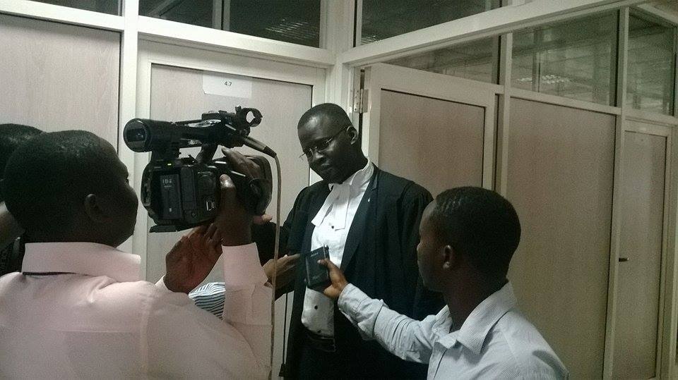 Counsel Nicholas Opio briefing the media at the constitutional court