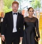 Il principe Harry, duca di Sussex (a sinistra) e la britannica Meghan, duchessa di Sussex (a destra) arrivano per assistere alla prima europea del film Il re leone a Londra il 14 luglio 2019.