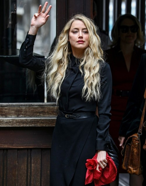 Amber Heard and Johnny Depp arrive at the Royal Courts of Justice for their final day