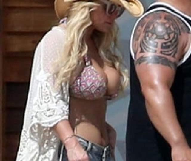 Jessica Simpson Stuffs Her Massive Boobs Into Tiny Bikini Top