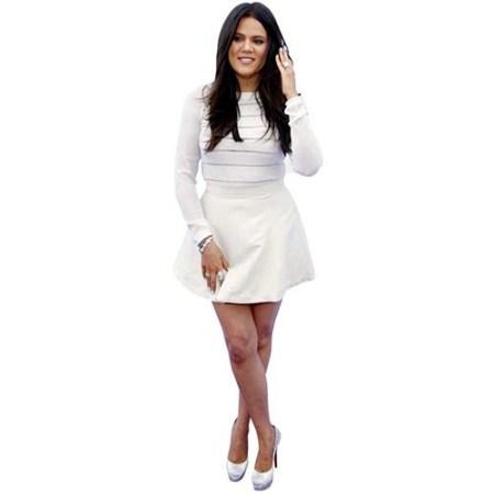 A Lifesize Cardboard Cutout of Khloe Kardashian wearing a short dress