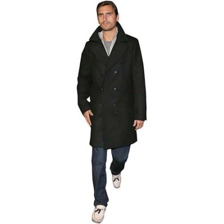 A Lifesize Cardboard Cutout of Scott Disick wearing a trench coat