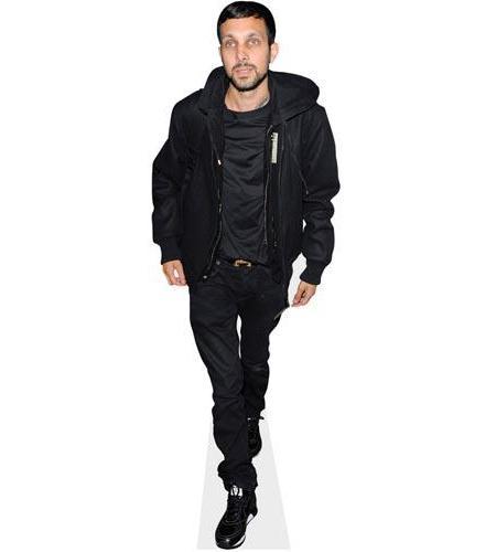 A Lifesize Cardboard Cutout of Dynamo wearing black