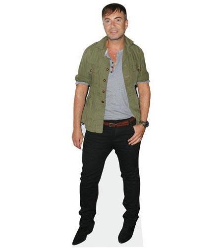 A Lifesize Cardboard Cutout of Julien MacDonald wearing jeans