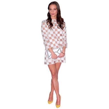 A Lifesize Cardboard Cutout of Alicia Vikander wearing a dress