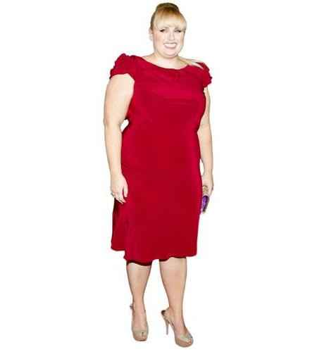 A Lifesize Cardboard Cutout of Rebel Wilson wearing a red dress