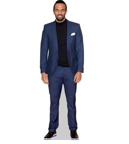 A Lifesize Cardboard Cutout of Craig David wearing a blue suit
