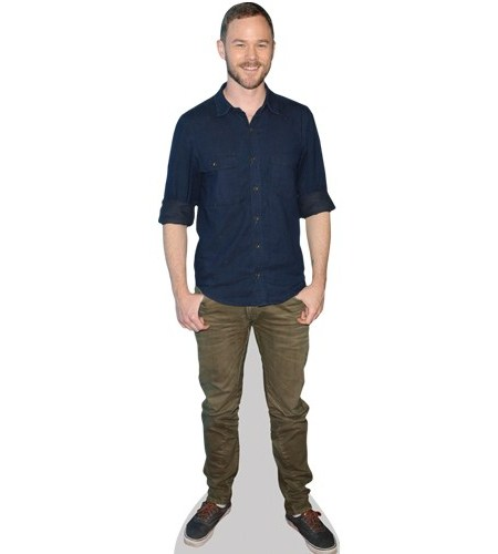 A Lifesize Cardboard Cutout of Aaron Ashmore wearing a blue shirt