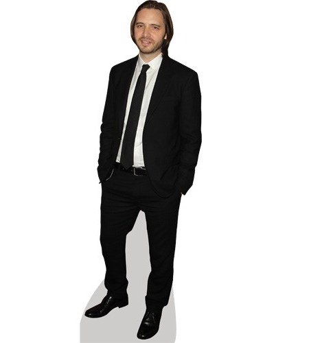 A Lifesize Cardboard Cutout of Aaron Stanford wearing a suit