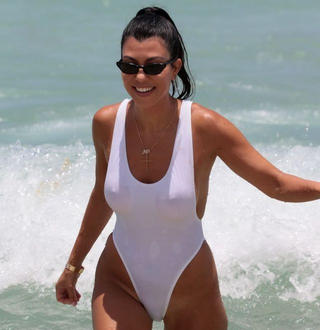Kourtney Kardashian Pokies In White Swimsuit At The Beach In Miami