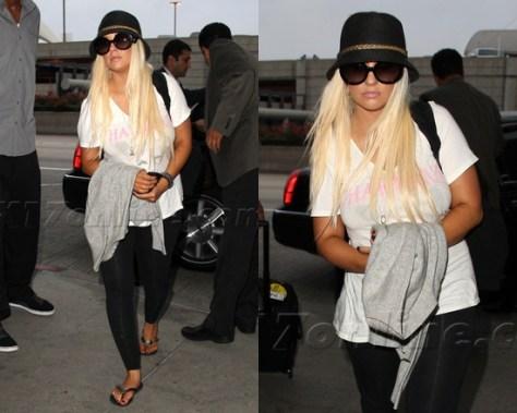 Christina Aguilera wearing Prada Baroque Round Sunglasses