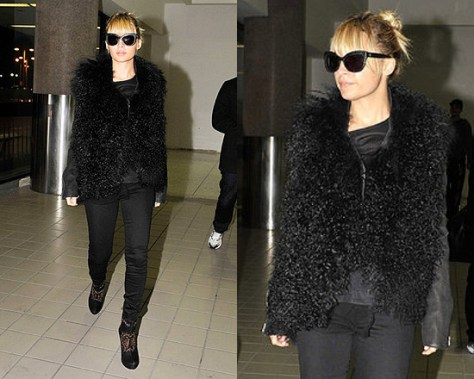 Nicole Richie at LAX wearing Helmut Lang Mongolian Fur Jacket