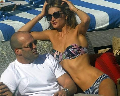 Rosie Huntington-Whiteley Poolside in Miami wearing Zimmermann Dreamer Mismatched Bikini
