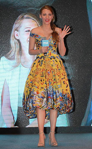 Blake Lively wears a Laurance Xu dress and Stuart Weitzman Nudist Single Band Platinum Sandals to the 'Age of Adaline' press conference in Beijing, China (May 11, 2015)