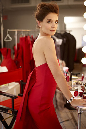 Katie Holmes in a Rosie Assoulin Draped Back Silk-Faille Column Gown for Olay