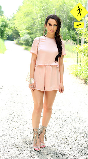 Carli Bybel in a Missguided pink silk romper and grey Schutz Kija Suede Fringe Sandals