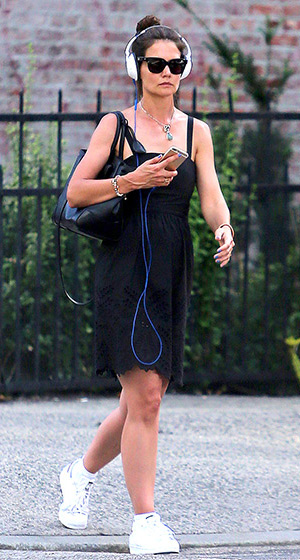 Katie Holmes listening to music as she steps out in New York City on July 20, 2015 wearing a Isabel Marant Étoile Serena Sleeveless Dress.