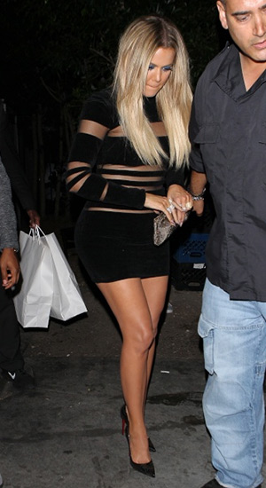 Khloe Kardashian wearing a Balmain Striped Chenille & Mesh Dress and Christian Louboutin Kristali Laser-Cut Patent Leather Pumps to Kylie Jenner's birthday dinner at The Nice Guy in West Hollywood, CA on August 9, 2015.