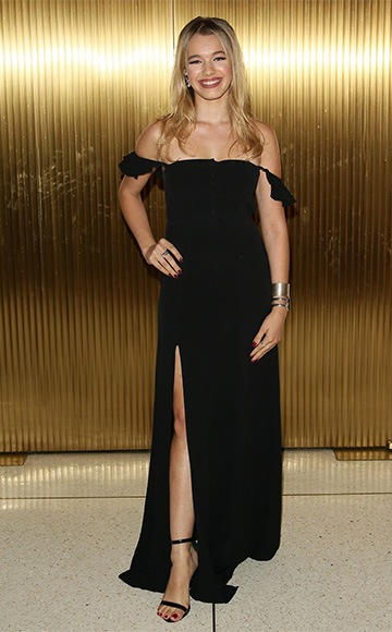 Sadie Calvano in a black Flynn Skye Bardot Maxi Dress at The 44th Annual Peace Over Violence Humanitarian Awards on October 16, 2015 in Los Angeles, CA.