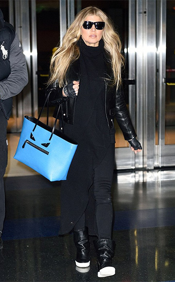 Spotted on Fergie - Saint Laurent classic biker jacket, Baja East ribbed tunic, a Fendi Monster tote in Blue and Giuseppe Zanotti Concealed Wedge Boots