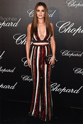 Cheryl in Zuhair Murad red stripe sequin jumpsuit and Fendi Mini 3baguette Embellished Leather Shoulder Bag at Cannes 2016