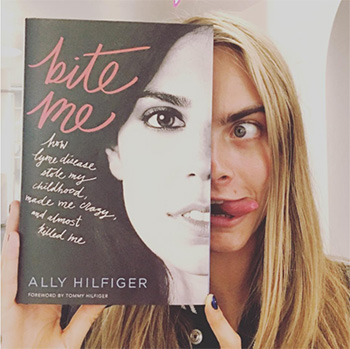 Cara Delevingne poses with her friend's book on Instagram called Bite Me: How Lyme Disease Stole My Childhood, Made Me Crazy, and Almost Killed Me by Ally Hilfiger