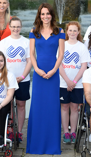 Duchess of Cambridge Kate Middleton wears a blue Roland Mouret Nansen Cold-Shoulder Gown as she hosts banquet for SportsAid charity at Kensington Palace on June 9, 2016.