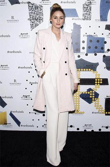 Olivia Palermo wears a Storets Momo Longline Linen Blazer with a Olivia Palermo + Chelsea28 Wide Leg Jumpsuit.