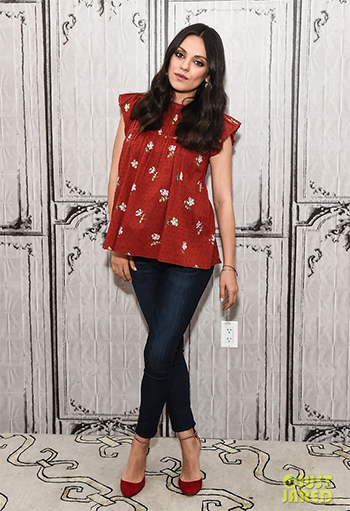 Mila Kunis promotes new movie Bad Moms, wearing a red Ulla Johnson Astrid Pleated Shoulder Blouse at AOL HQ in NYC on July 20, 2016.