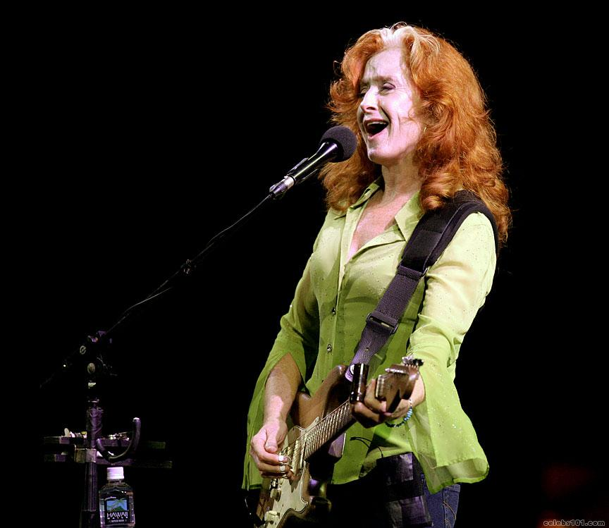 Bonnie Raitt playing slide guitar