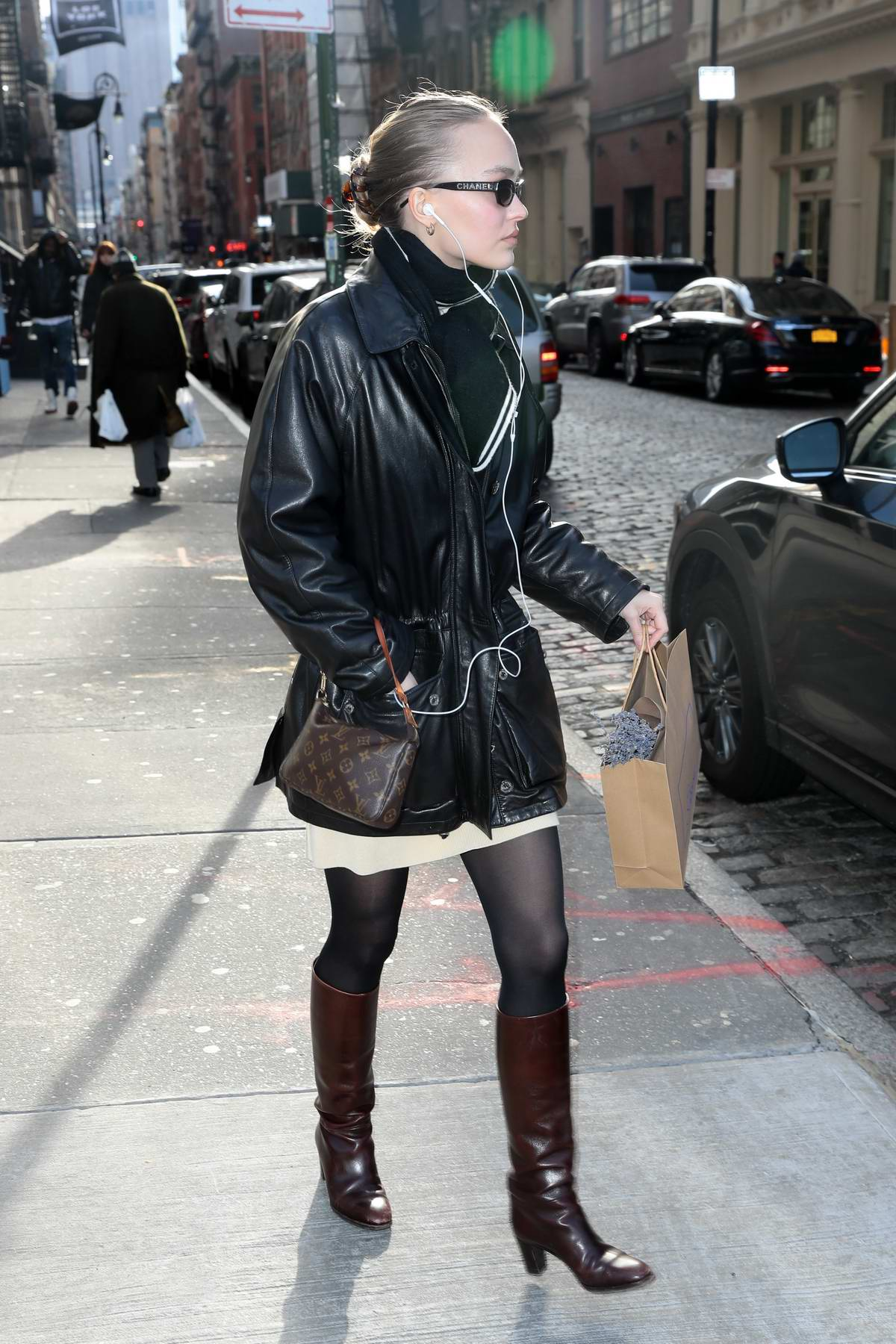 Lily Rose Depp Steps Out In A Black Leather Jacket Brown Knee High Boots And Louis Vuitton