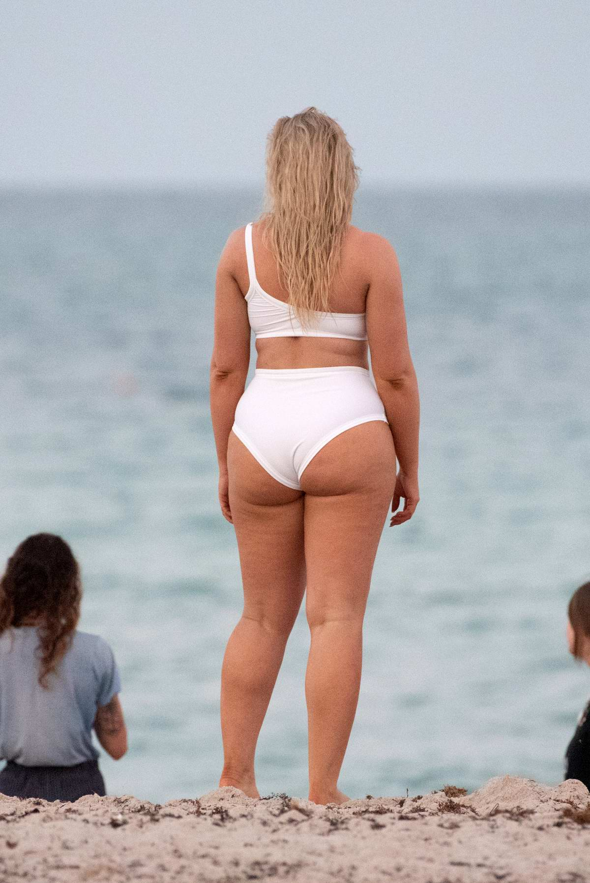 Iskra Lawrence Sports A White Bikini During A Night