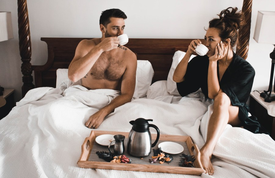 Couple having breakfast in bed, celebrating intimacy in longterm relationships