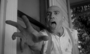 Sid Haig gesturing toward the viewer and screaming in a black-and-white photo from the movie Spider Baby