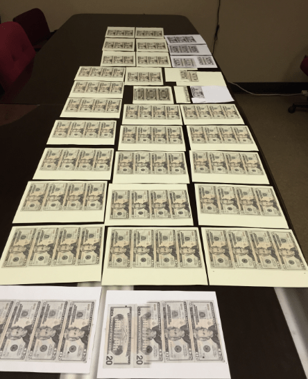 Sheets of counterfeit bills_1452293490212.PNG